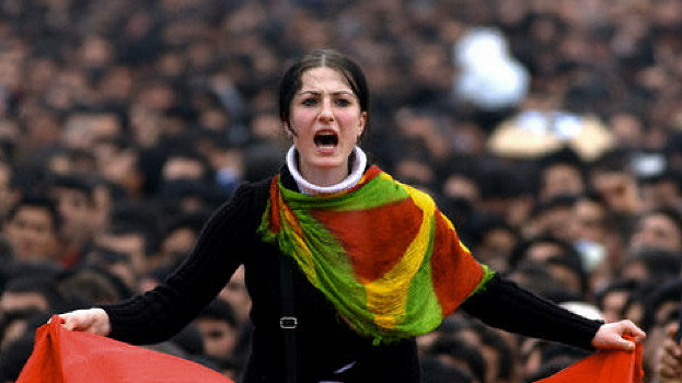 Kurdish girl shouts slogans as thousands of Turkish Kurds gather to celebrate Newroz in Diyarbakir